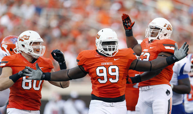 photo - CELEBRATION: Oklahoma State's Cooper Bassett (80), Calvin Barnett (99) and Ryan Simmons (52) celebrate during a college football game between Oklahoma State University (OSU) and Savannah State University at Boone Pickens Stadium in Stillwater, Okla., Saturday, Sept. 1, 2012. Photo by Sarah Phipps, The Oklahoman