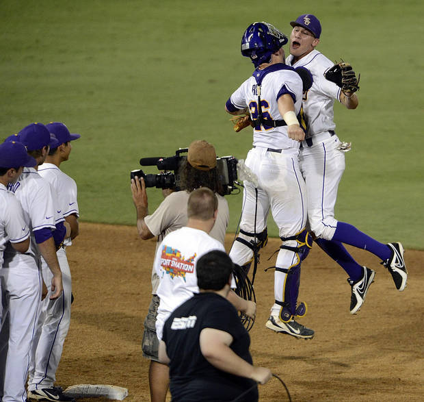 photo - LSU's Ty Ross (26) and JaCoby Jones, right, celebrate after an NCAA college baseball tournament regional game against Oklahoma, Friday, June 7, 2013, in Baton Rouge, La. LSU won 2-0. (AP Photo/Bill Feig) ORG XMIT: LABF103