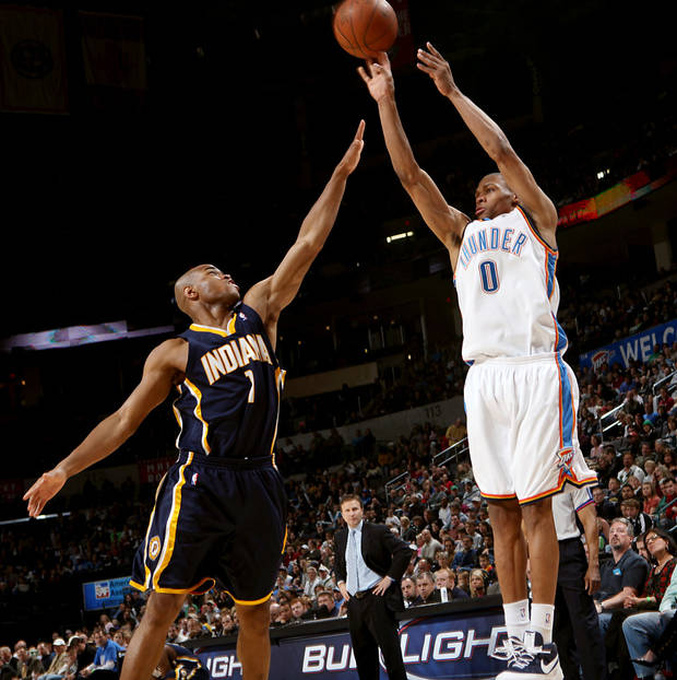 photo - Oklahoma City's Russell Westbrook takes a shot over Indiana's Jarrett Jack during the NBA basketball game between the Indiana Pacers and the Oklahoma City Thunder at the Ford Center in Oklahoma City, Sunday, April 5, 2009. Photo by John Clanton, The Oklahoman