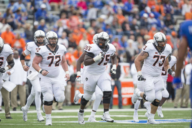 Oklahoma State's offensive line, despite some injuries on Saturday, was much improved. Pictured here are Johnny Wilson, No. 72), Marcus Keyes (No. 75) and Teven Jenkins (No. 73). [PHOTO BY BRUCE WATERFIELD, Courtesy OSU Athletics]