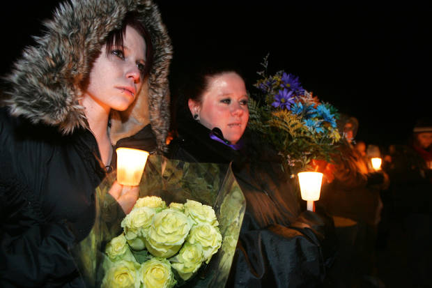 photo - Kayla James and Nicole Williams take part in a candlelight vigil in El Reno for Summer Rust and her four children. PHOTO BY STEVE GOOCH, THE OKLAHOMAN