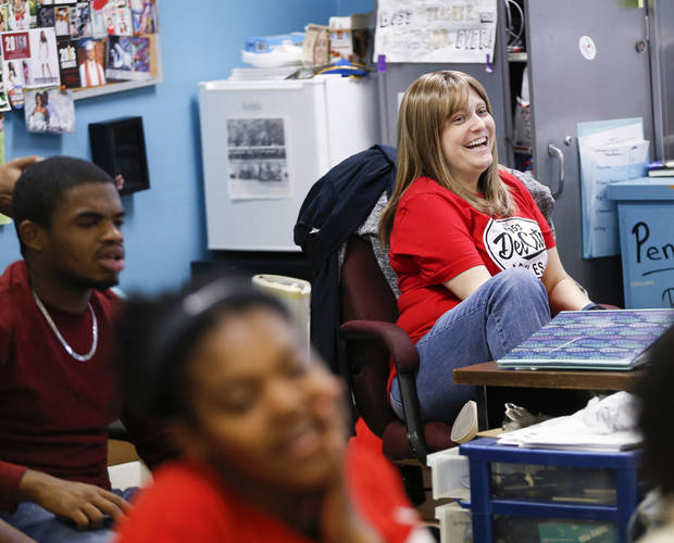Kristy Cooper, a teacher at Del City High School, laughs as her former students who are now college freshmen speak to one of her leadership classes, in Del City, Okla., Wednesday, Dec. 13, 2017. Photo by Nate Billings, The Oklahoman