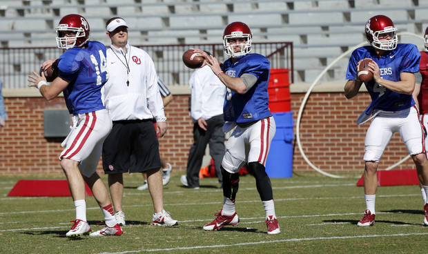 photo - Quarterbacks Cody Thomas, Trevor Knight and Justice Hansen go through drills as the University of Oklahoma Sooners (OU) begin spring practice on Owen Field at Gaylord Family-Oklahoma Memorial Stadium in Norman, Okla., on Tuesday, March 11, 2014. Photo by Steve Sisney, The Oklahoman