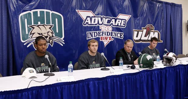 photo - Ohio's safety Gerald Moore, left, running back Beau Blankenship, second from left,  and quarterback Tyler Tettleton, listen as coach Frank Solich, second from right, answers reporters questions during a NCAA college football news conference for the Independence Bowl, Thursday, Dec. 27, 2012, in Shreveport, La. Ohio is scheduled to play Louisiana-Monroe Friday. (AP Photo/Rogelio V. Solis) ORG XMIT: LARS106