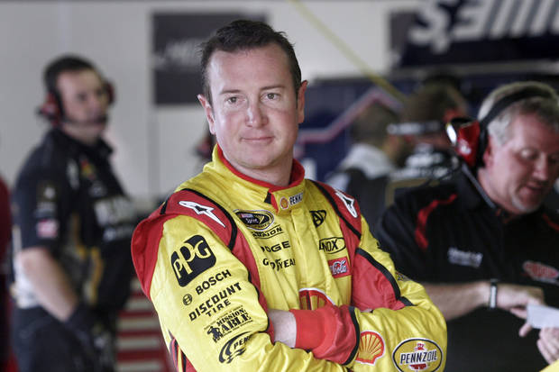 photo - Kurt Busch waits in the garage during practice for the NASCAR Sprint Cup Series Pure Michigan 400 auto race at Michigan International Speedway in Brooklyn, Mich., Saturday, Aug. 20, 2011. (AP Photo/Luke Brodbeck) ORG XMIT: MIPS102