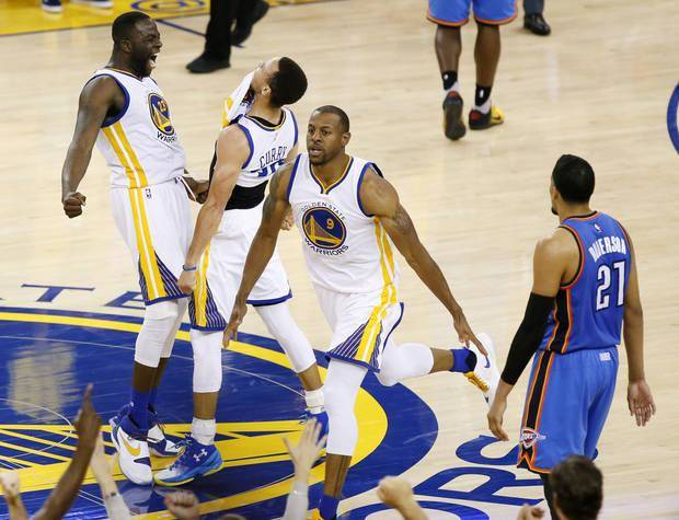 Golden State's Draymond Green (23), Stephen Curry (30) and Andre Iguodala (9) celebrate a 3-point shot by Curry in the final minute near Oklahoma City's Andre Roberson (21) during Game 7 of the Western Conference finals in the NBA playoffs between the Oklahoma City Thunder and the Golden State Warriors at Oracle Arena in Oakland, Calif., Monday, May 30, 2016. Golden State won 96-88. Photo by Nate Billings, The Oklahoman