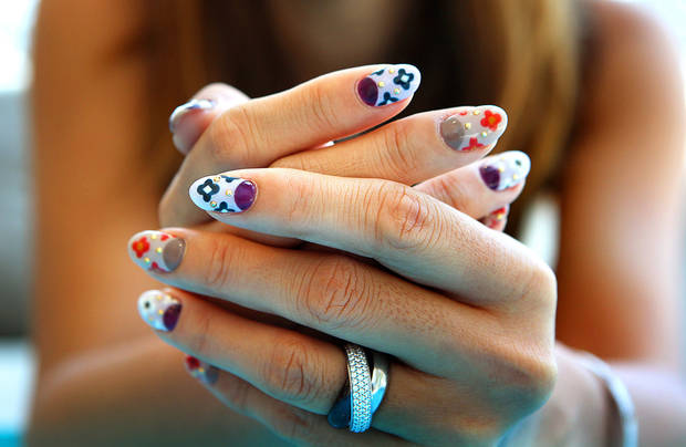 photo - Owner Hiroko Fujikawa shows off her nail design inspired by the Prada Fall/Winter collection 2012, at MARS The Salon in West Hollywood, California, on Tuesday, July 3, 2012. (Christina House/Los Angeles Times/MCT)