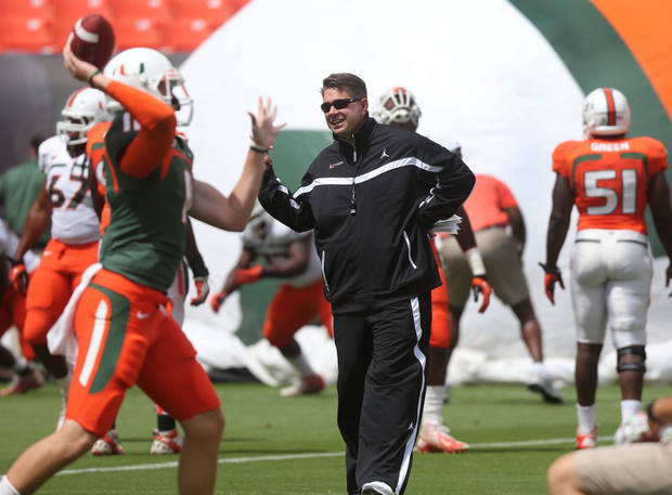 photo - Miami coach Al Golden walks through player warm ups before their spring NCAA college football game on Saturday, April 13, 2013, at Sunlife Stadium in Miami Gardens, Fla. (AP Photo/The Miami Herald, (AP Photo/The Miami Herald, )  MAGS OUT) ORG XMIT: FLMIH204
