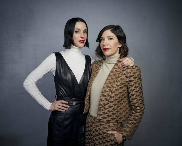 "St. Vincent, left, and Carrie Brownstein pose for a portrait to promote the film ""The Nowhere Inn"" at the Music Lodge during the Sundance Film Festival on Saturday, Jan. 25, 2020, in Park City, Utah. [Photo by Taylor Jewell/Invision/AP]"