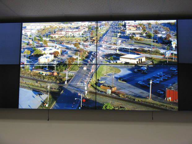 A four-screen view of 33rd Street and Broadway can be seen from within the new traffic management center as part of the intelligent transportation system. [PHOTO BY DIANA BALDWIN, THE OKLAHOMAN] |
