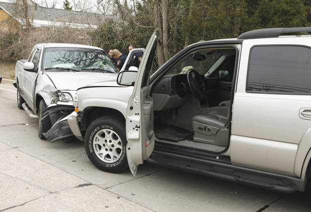 photo - The driver of the pickup, at left, fled from a traffic stop Tuesday before crashing her vehicle and being arrested in Norman.Photo by Steve Sisney, The Oklahoman
