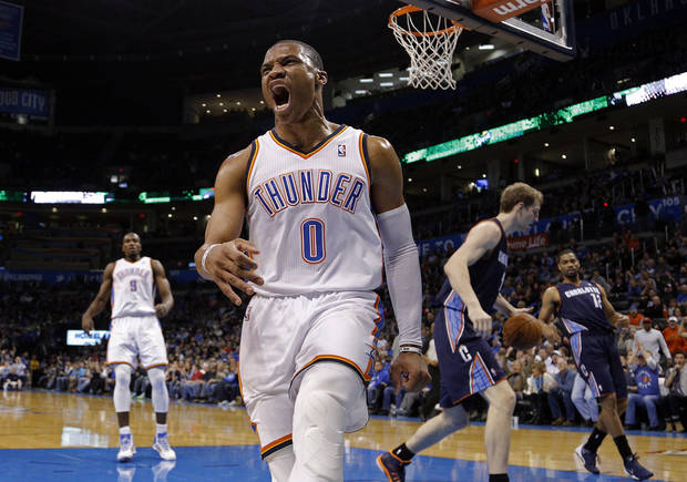 photo - Oklahoma City 's Russell Westbrook (0) celebrates his dunk during the NBA basketball game between the Oklahoma City Thunder and the Charlotte Bobcats at the Chesapeake Energy Arena, Sunday, March 2, 2014. Photo by Sarah Phipps, The Oklahoman