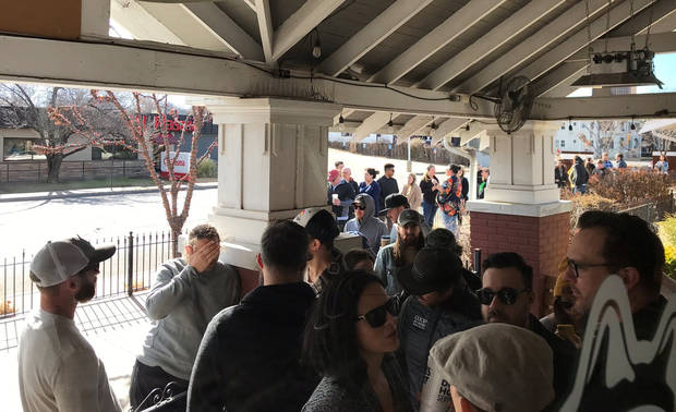A hungry throng lines up outside ChickNBeer waiting for spicy wings and okra from celebrity chef Danny Bowien on New Year's Day in Oklahoma City. [Dave Cathey/The Oklahoman]