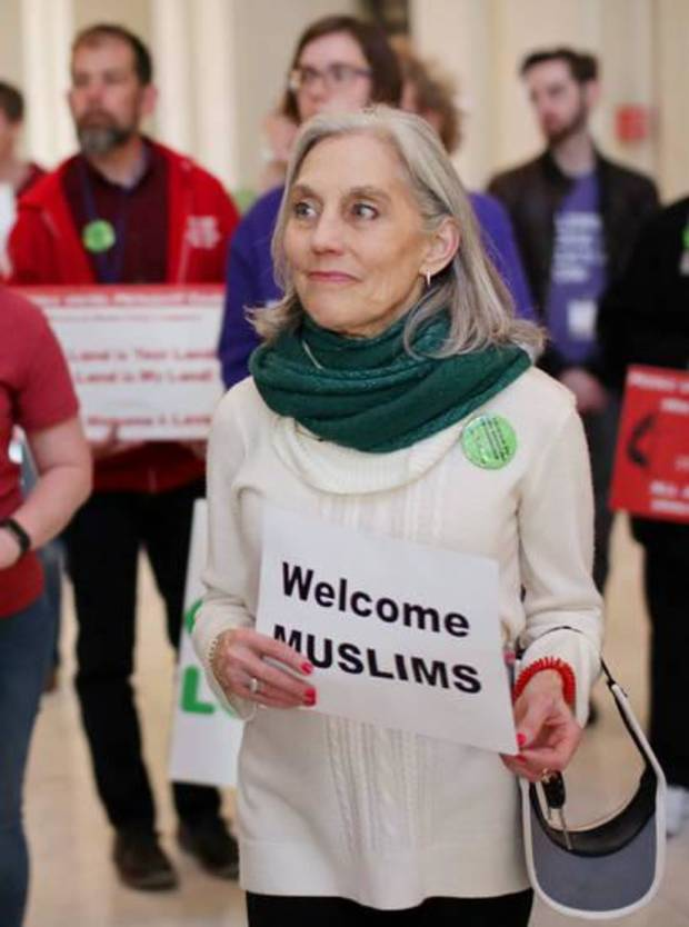 Joan Korenblit of Edmond, co-founder of the Respect Diversity Foundation, holds a sign of support during the third annual Muslim Day at the Capitol in March 2017. [Photo by Doug Hoke, The Oklahoman]