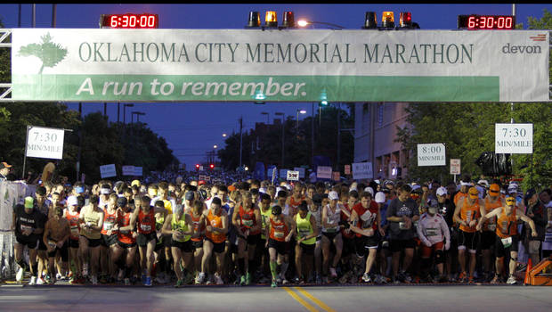 photo - RUN / RUNNERS / RUNNING: Runners start the Oklahoma City Memorial Marathon in Oklahoma City, Sunday, April 29, 2012. Photo by Bryan Terry, The Oklahoman