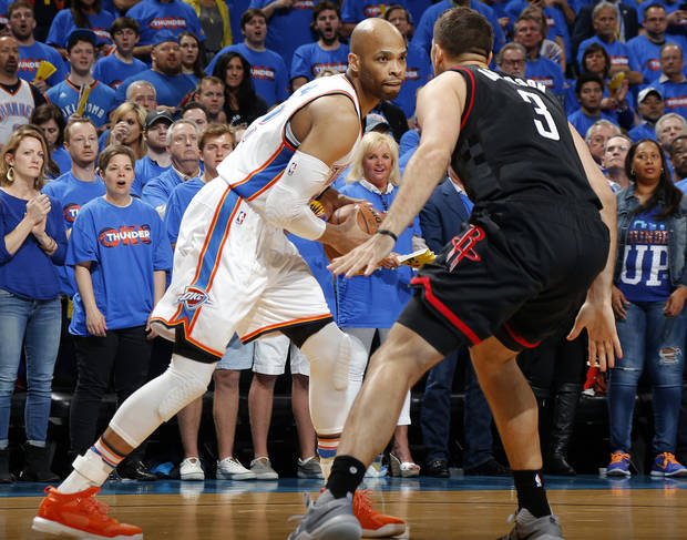 Oklahoma City's Taj Gibson (22) looks to pass around Houston's Ryan Anderson (3) during Game 3 in the first round of the NBA basketball playoffs between the Oklahoma City Thunder and the Houston Rockets at Chesapeake Energy Arena in Oklahoma City, Friday, April 21, 2017.  Photo by Nate Billings, The Oklahoman