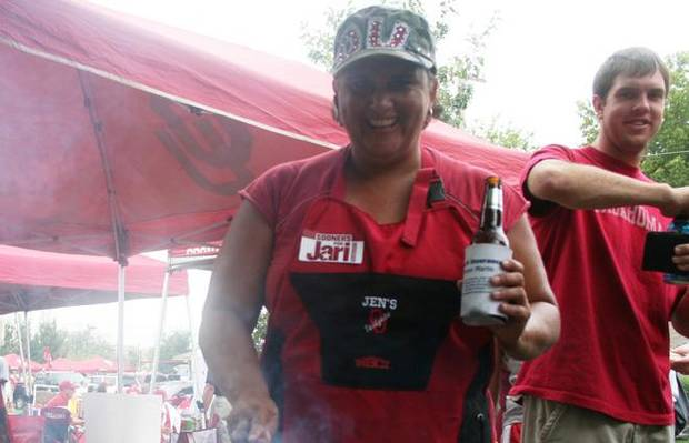 photo - Jennifer Aleman who, arguably, makes the best tailgate cheeseburgers lays spatula to grill.
