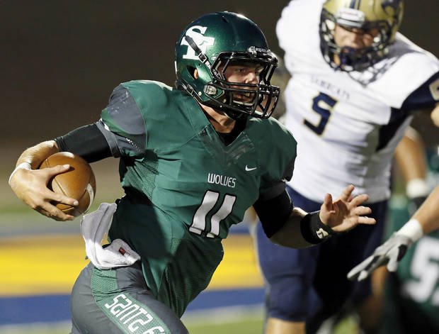 photo - Edmond Santa Fe's Justice Hansen (11) keeps the ball during a high school football game between Edmond Santa Fe and Southmoore at Wantland Stadium in Edmond, Okla., Thursday, Sept. 20, 2012. Photo by Nate Billings, The Oklahoman