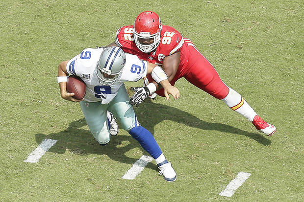 photo - Dallas Cowboys quarterback Tony Romo (9) is sacked by Kansas City Chiefs nose tackle Dontari Poe (92) during the second half of an NFL football game at Arrowhead Stadium in Kansas City, Mo., Sunday, Sept. 15, 2013. (AP Photo/Charlie Riedel)