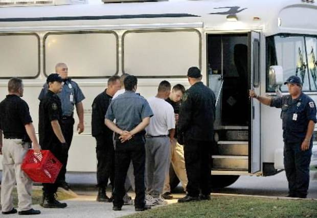 photo - Twenty three inmates were transferred from the Oklahoma Department of Corrections into the custody of the Immigration and Customs Enforcement Agency just before sunrise Thursday, July 23, 2009. The transfer took place at the John Lilley facility in Boley. The prisoners, who are  illegal immigrants, will be deported to their home country. Photo by Jim  Beckel