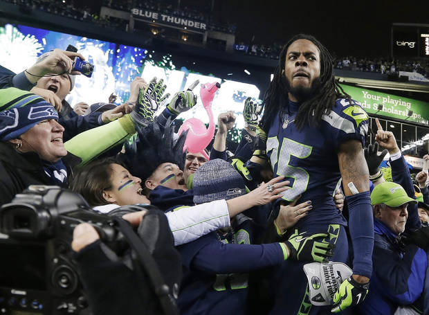 photo - ADVANCE FOR WEEKEND EDITIONS, JAN. 25-26 - In this Jan. 19, 2013, file photo, Seattle Seahawks' Richard Sherman celebrates with fans after after the  NFC championship NFL football game against the San Francisco 49ers in Seattle. The last time one of Seattle's major franchises had a parade to celebrate a title, no one on the Seahawks roster was born. To call Seattle's championship history thin is an understatement. Maybe that's why there's so much support behind these Super Bowl-bound Seahawks. (AP Photo/Elaine Thompson, File)