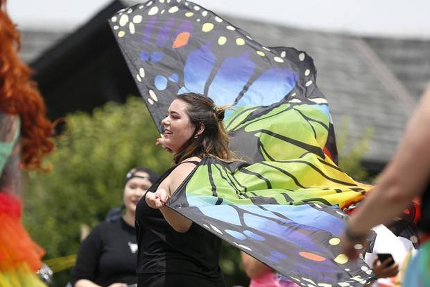 A women waves butterfly wings as she walks through the 2019 OKC Pride Parade down the 39th Street district in Oklahoma City, Oklahoma on Saturday, June 22, 2019. [The Oklahoman Archives]
