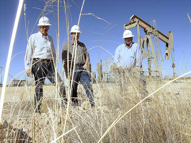 photo - Devon Energy's Don Mayberry, Wyatt Abbitt and Tracy Kidd discuss rangeland restoration efforts undertaken by the company at this Permian Basin well site southeast of Artesia, N.M. The company replanted land surrounding the well after completing its drilling. Photo By Jack Money, The Oklahoman