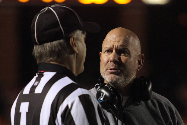 photo - Yukon Miller coach Todd Wilson talks to the officials about a call during the Yukon - Putnam City North high school football game Thursday night in Yukon. Photo by Hugh Scott, for the Oklahoman