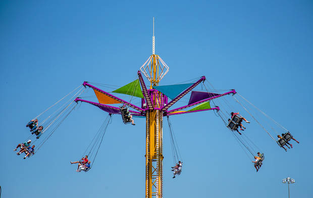 Thrill seekers enjoy the rides on the midway during the opening day of the 2017 Oklahoma State Fair in Oklahoma City, Okla. on Thursday, Sept. 14, 2017. Photo by Chris Landsberger, The Oklahoman