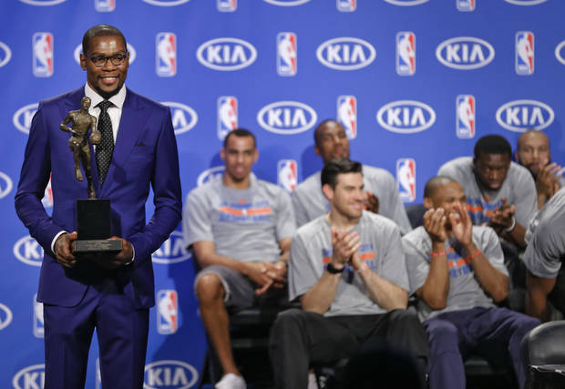 photo - Oklahoma City Thunder's Kevin Durant poses for a photo with the MVP trophy during a news conference announcing  Durant as the winner of the 2013-14 Kia NBA Basketball Most Value Player Award in Oklahoma City, Okla. on Tuesday, May 6, 2014. Photo by Chris Landsberger, The Oklahoman