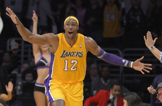 photo - Los Angeles Lakers center Dwight Howard celebrates after hitting a three point shot during the second half of their NBA basketball game against the Denver Nuggets, Friday, Nov. 30, 2012, in Los Angeles. The Lakers won 122-103. (AP Photo/Mark J. Terrill)  ORG XMIT: LAS108
