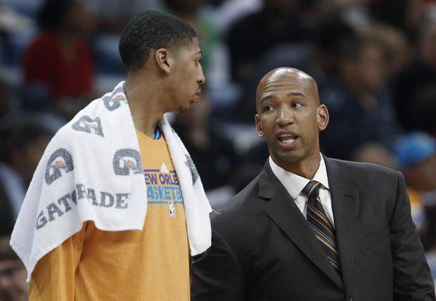New Orleans Hornets coach Monty Williams talks with forward Anthony Davis during the first half of an NBA basketball game against the Memphis Grizzlies in New Orleans, Friday, March 22, 2013. (AP Photo/Bill Haber)