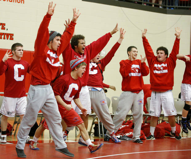 photo - Collinsville celebrates their win the Class 5A Dual State wrestling championship in Yukon, Okla., Saturday, Feb. 15, 2014. Photo by Bryan Terry, The Oklahoman