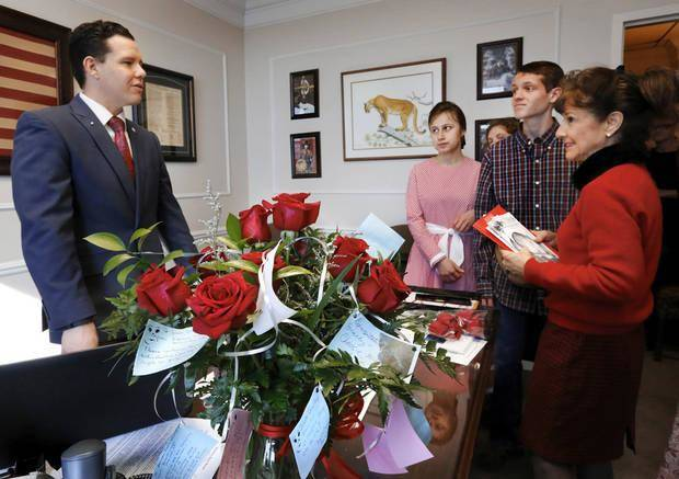 In this Feb. 8, 2017 photo, a group of sanctity-of-life advocates from Seminole visit Sen. Jason Smalley after delivering flowers to his office during Rose Day activities at the state Capitol. [ Photo by Jim Beckel, The Oklahoman]