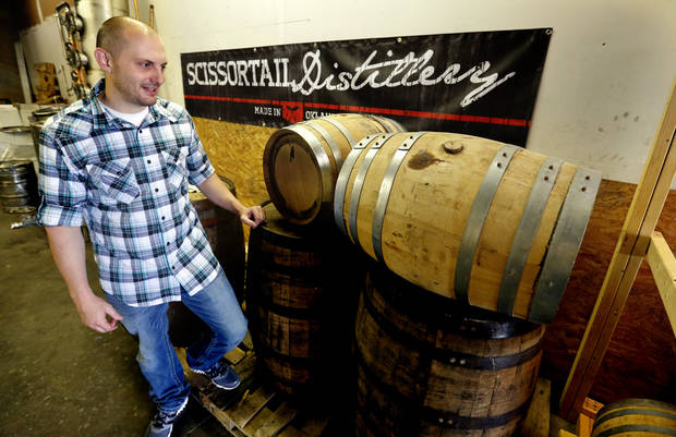 photo -  Garrett Janko shows off his bourbon operation at Scissortail Distillery in Moore. Photo by Steve Sisney, The Oklahoman   STEVE SISNEY -