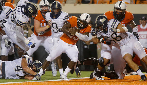 Oklahoma State's Rennie Childs (23) scores the game winning touchdown during a college football game between the Oklahoma State Cowboys (OSU) and the Pitt Panthers at Boone Pickens Stadium in Stillwater, Okla., Saturday, Sept. 17, 2016. Photo by Chris Landsberger, The Oklahoman