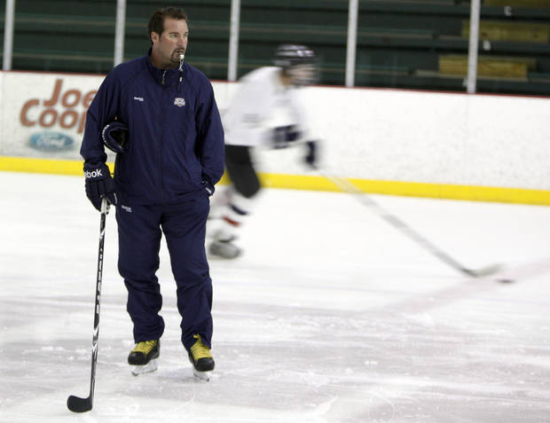 photo - Todd Nelson helps coach his son's hockey team at the Blazers Ice Centre in Oklahoma City, Wednesday, Aug. 24, 2011. Photo by Sarah Phipps, The Oklahoman