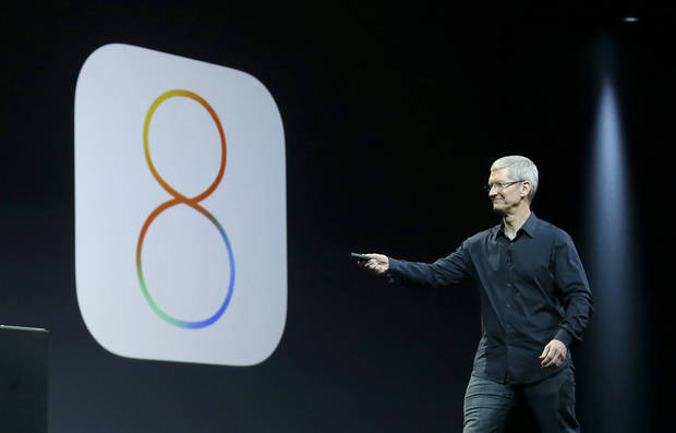 photo - Apple CEO Tim Cook speaks about iOS 8 at the Apple Worldwide Developers Conference in San Francisco, Monday, June 2, 2014. (AP Photo/Jeff Chiu)
