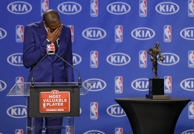photo - Oklahoma City Thunder's Kevin Durant wipes the tears from his eyes during a news conference announcing Durant as the winner of the 2013-14 Kia NBA Basketball Most Value Player Award in Oklahoma City, Okla. on Tuesday, May 6, 2014. Photo by Chris Landsberger, The Oklahoman