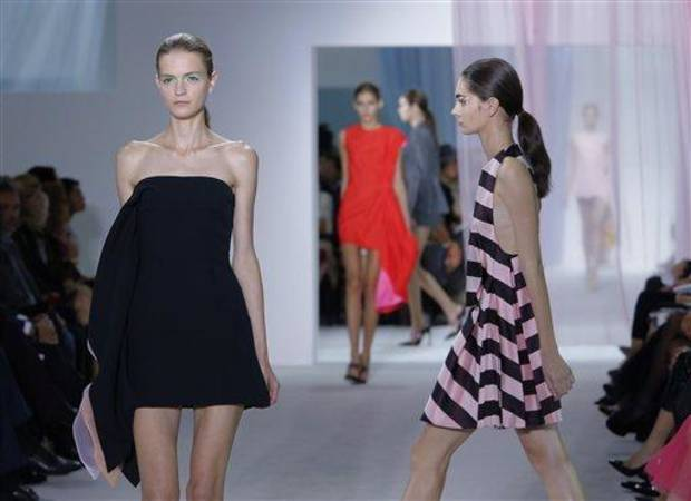 photo - Models wear creations from Belgian fashion designer Raf Simmons for Dior ready to wear Spring-Summer 2013 collection, presented in Paris, Friday, Sept. 28, 2012. (AP Photo/Jacques Brinon)