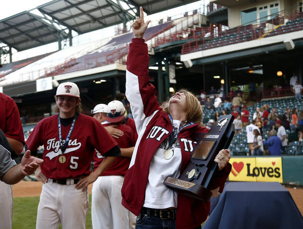photo - Kim Tiderman looks up after receiving the 4A state baseball championship trophy during the class 4A state baseball championship game between Tuttle and Dewey at the Chickasaw Bricktown Ballpark in Oklahoma City, Saturday, May 17, 2014. Photo by Sarah Phipps, The Oklahoman