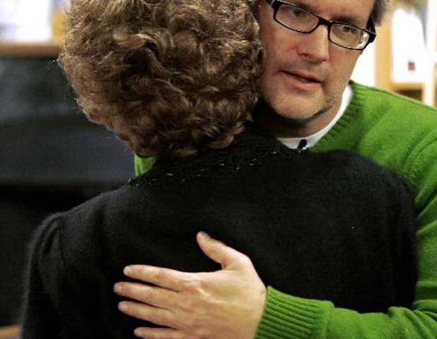 photo - Jim Chastain receives a hug from his grandmother during his birthday party at Full Circle Books in Oklahoma City on Dec. 10, 2008. Photo by John Clanton