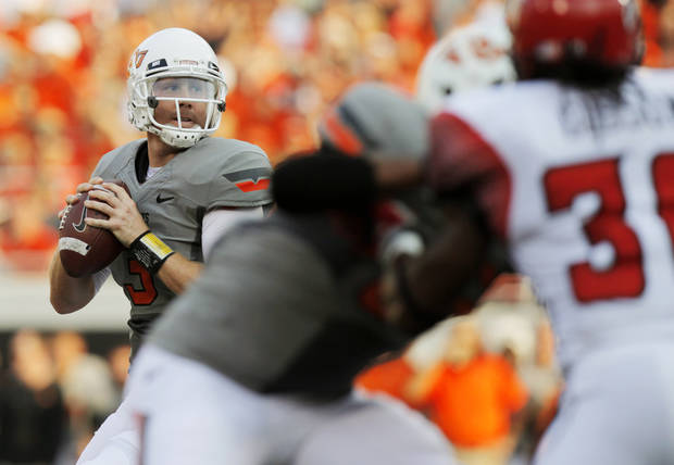 photo - OSU's Brandon Weeden looks to pass during the Cowboys game vs. ULL. Photo by Nate Billings, The Oklahoman
