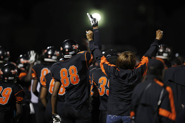 photo - Douglass players cheer from the sidelines during a high school football game between Douglass and Ada at Moses F. Miller Stadium in Oklahoma City, Friday, Nov. 2, 2012.  Photo from The Oklahoman Archives