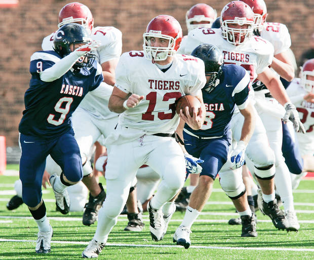 photo - Tuttle's Sterling Koons breaks away from the Cascia Hall defense during Saturday's game. Photo BY STEVE GOOCH, THE OKLAHOMAN
