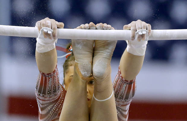 OU's Maggie Nichols performs in the uneven bars Perfect 10 Challenge women's gymnastics meet between Oklahoma and Nebraska, part of the Bart and Nadia Sports Experience, at the Cox Convention Center in Oklahoma City, Friday, Feb. 16, 2018. Photo by Sarah Phipps, The Oklahoman