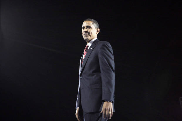 photo - President-elect Barack Obama smiles Tuesday night after his acceptance speech in Chicago.