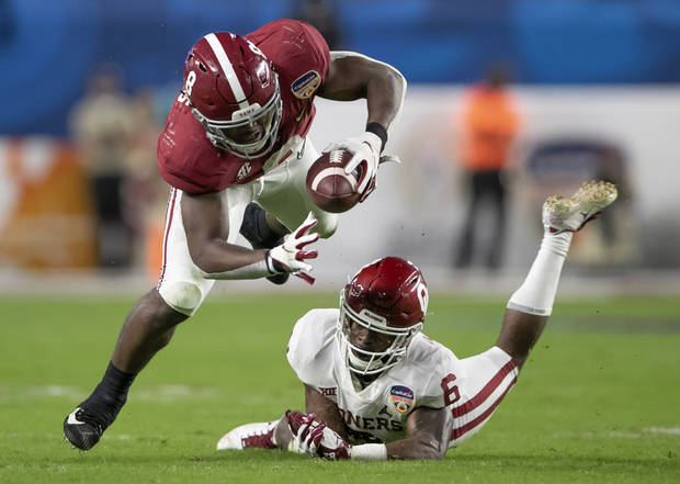 Alabama Crimson Tide running back Josh Jacobs (8) is stopped for no gain by Oklahoma Sooners cornerback Tre Brown (6) in the College Football Playoff semifinals in the Orange Bowl at Hard Rock Stadium in Miami Gardens, Florida on December 29, 2018. [ALLEN EYESTONE/palmbeachpost.com]