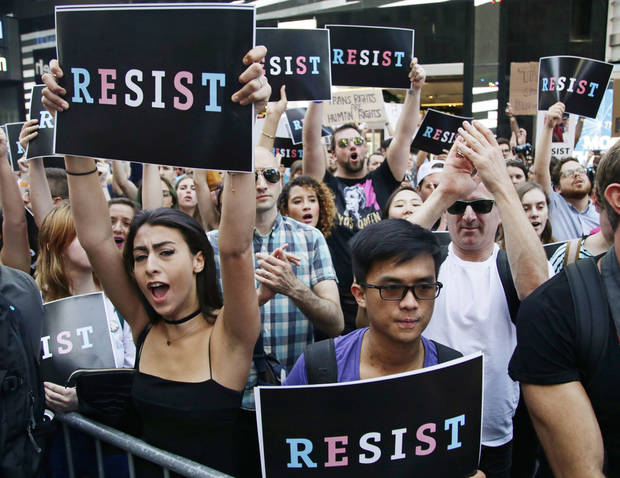 Protestors react as New York City Public Advocate Letitia James speaks during a rally in Times Square, Wednesday, July 26, 2017, in New York. The rally was held in protest of President Donald Trump's announcement of a ban on transgender troops serving anywhere in the U.S. military. (AP Photo/Frank Franklin II)