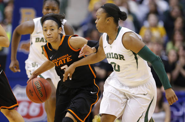 photo - Oklahoma State's Tiffany Bias (3) goes past Baylor's Odyssey Sims (0) during the Big 12 tournament women's college basketball game between Oklahoma State University and Baylor at American Airlines Arena in Dallas, Sunday, March 10, 2012.  Oklahoma State lost 77-69. Photo by Bryan Terry, The Oklahoman